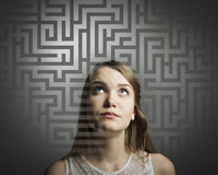 Maze. Girl in white solving a problem. Stock Photo