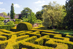 The Maze, Hampton Court, Herefordshire, England. Part of the maze and walled garden with Hampton Court in the background Stock Photos