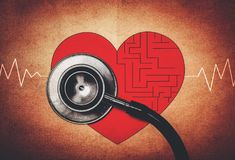 Maze in heart symbol with stethoscope. Retro effect stock image