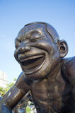 A-maze-ing Laughter. June 7 - Vancouver, British Columbia - Head of one of fourteen bronze statues that form A-maze-ing Laughter, an outdoor sculpture in English stock photo