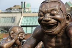 A-Maze-Ing Laughter. The A-Maze-Ing Laughter statues by Chinese artist Yue Minjun at English Bay, Vancouver, Canada stock photos