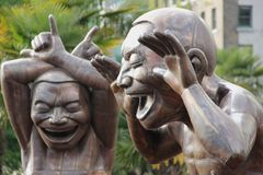 A-Maze-Ing Laughter. The A-Maze-Ing Laughter statues by Chinese artist Yue Minjun at English Bay, Vancouver, Canada Stock Photography