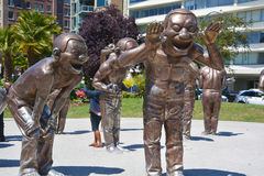A-maze-ing Laughter. VANCOUVER BC CANADA JUNE 15 2015: A-maze-ing Laughter is a 2009 bronze sculpture by Yue Minjun, located in Morton Park in Vancouver, British stock photos