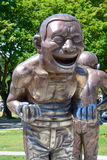 A-maze-ing Laughter. VANCOUVER BC CANADA JUNE 15 2015: A-maze-ing Laughter is a 2009 bronze sculpture by Yue Minjun, located in Morton Park in Vancouver, British royalty free stock photo