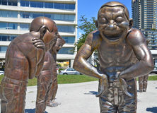 A-maze-ing Laughter. VANCOUVER BC CANADA JUNE 15 2015: A-maze-ing Laughter is a 2009 bronze sculpture by Yue Minjun, located in Morton Park in Vancouver, British stock photo