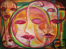 Maze of Masks. A maze of brilliant colorful faces in an oil painting Stock Image