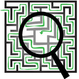 Maze Puzzle Magnifying Glass Symbols Find Things. A magnifying glass to search and find a solution in a maze puzzle Royalty Free Stock Photography