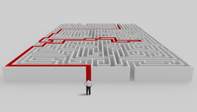 Maze and solution. Businessman in front of a maze with solution