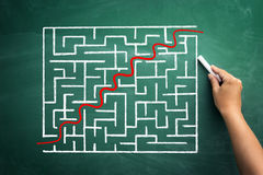 Through the maze to success. Red curve line going through the maze to success Stock Photo