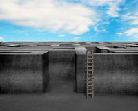 Maze with wooden ladder and blue sky stock photo