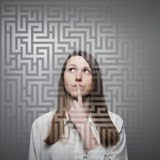 Maze. Young woman looking for the solution Stock Image