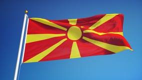 Mazedonien-Flagge in der Zeitlupe schlang nahtlos sich mit Alpha stock abbildung