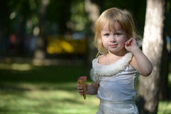 MAZNEV GENNADY. Cute little blonde girl is backlit against the background of Stock Photography