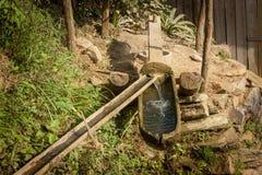 Mazo y mortero grandes para el poder de agua Imagenes de archivo