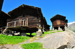 Mazots in Saas Fee. Mazots alpine meadow huts used for storing grain are built on piles of stones always with a large round stone to prevent rodents from getting Royalty Free Stock Image