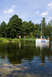 Mazury lakes. A boat entering Mamry lake through the channel royalty free stock photo