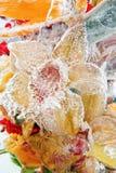 Mazzo congelato dei fiori arancio Immagini Stock Libere da Diritti