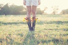 Mazzo creativo in stivali fotografie stock