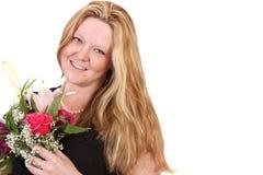 Mazzo del fiore della holding della donna Immagine Stock Libera da Diritti