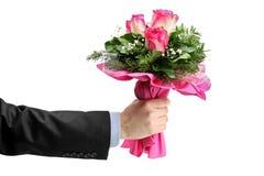 Mazzo della holding della mano di rose Fotografia Stock Libera da Diritti