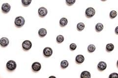 Mazzo di bacche organiche fresche del mirtillo nel modello senza cuciture su fondo bianco Concetto pulito di cibo Vegano nutrient fotografia stock