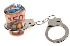 Mazzo di banconote nell'euro ammanettato immagine stock libera da diritti
