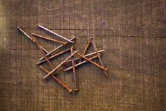 Mazzo di chiodi arrugginiti Fotografie Stock