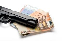 Mazzo di euro banconote con una pistola Immagine Stock Libera da Diritti