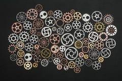 Mazzo di ruote dentate su fondo nero Fotografia Stock Libera da Diritti