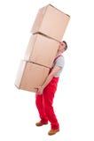 Mazzo di sollevamento dell'uomo di scatole di cartone pesanti Fotografie Stock