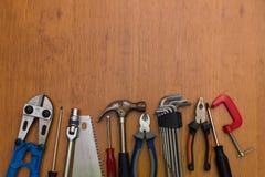 Mazzo di strumenti del lavoro allineati Fotografie Stock Libere da Diritti