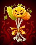 Mazzo divertente fatto delle zucche di Halloween sulle ossa Fotografie Stock Libere da Diritti