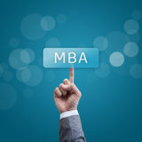 MBA. hand man pressing mba button. Royalty Free Stock Photos
