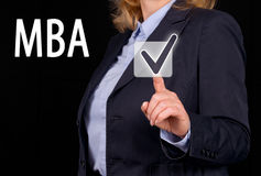 MBA - Master of Business Administration. Businesswoman with touchscreen button and text stock photography