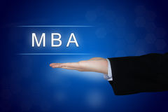 MBA or Master of Business Administration button on blue background. MBA or Master of Business Administration button with business hand stock photos