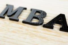 MBA-teken op houten achtergrond Royalty-vrije Stock Foto's