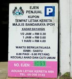 MBI Parking Coupon Advertising Board. An advertising board for the purchase of the Ipoh City Council Majlis Bandaraya Ipoh - MBI parking coupon by an MBI agent Stock Photo