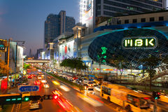 MBK center is a shopping mall in Bangkok. Bangkok,Thailand - April 04,2015 : Time-lapse, Traffic on street and MBK Center Bangkok Shopping Mall on April 04,2015 Royalty Free Stock Photos
