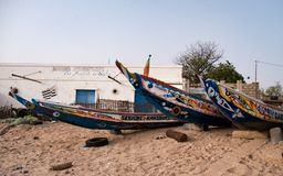 Mbour, Senegal: Colourful fishing boats stranded in the sand stock images