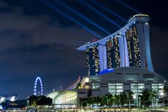 MBS Hotel with Light Show. Marina Bay Sands Hotel with light show and Singapore Flyer seen from the background and Shoppes by the Bay on the foreground Stock Image