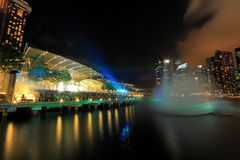 MBS light show Singapore. The public enjoying the light show at MBS with the city nights cape as the back drop. The light show named Wonder full lasted for Royalty Free Stock Photo