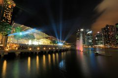 MBS light show Singapore. The public enjoying the light show at MBS with the city nights cape as the back drop. The light show named Wonder full lasted for Royalty Free Stock Images