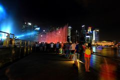 MBS light show Singapore. The public enjoying the light show at MBS with the city nights cape as the back drop. The light show named Wonder full lasted for Royalty Free Stock Photography