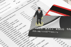 MBusinessman Figurine on Credit Cards Royalty Free Stock Photos