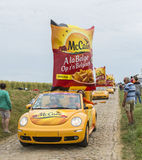 Mc Cain Caravan on a Cobblestone Road- Tour de France 2015 Stock Image