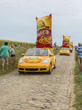 Mc Cain Caravan on a Cobblestone Road- Tour de France 2015 Royalty Free Stock Photos