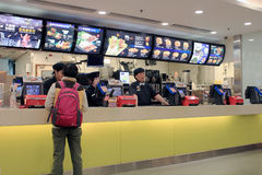 Mc Donalds Restaurant. December 5, 2013 - People buying fast-food from McDonalds Restaurant, located in Metro City Plaza, Hong Kong Royalty Free Stock Photos