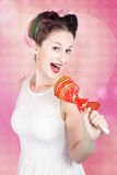 MC female pin up singing with lollipop microphone Stock Images