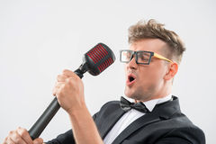 Mc singing in microphone Royalty Free Stock Image