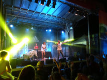 MC Yogi and Trevor Hall preforms on stage with DJ Drez Stock Image